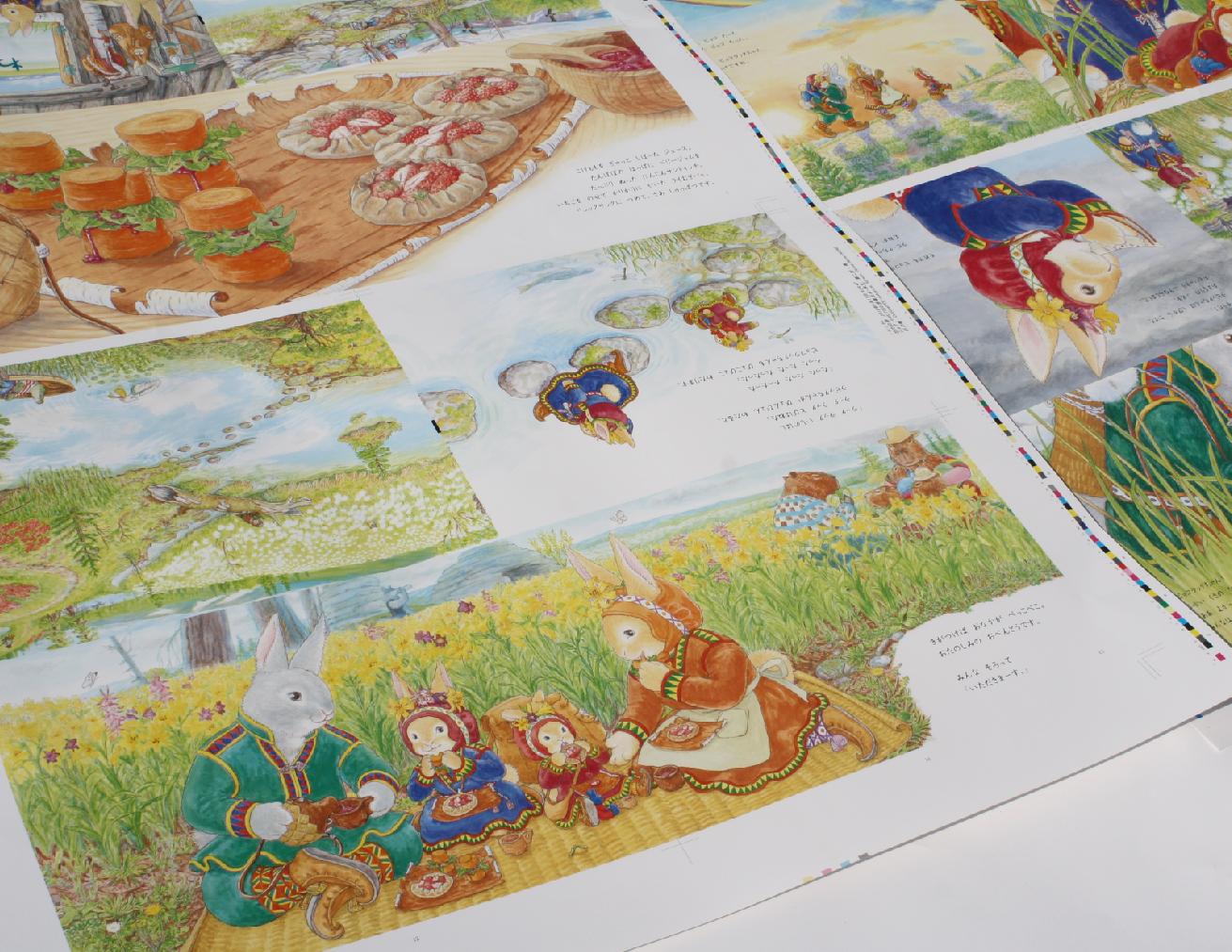 色校正。大きな紙に絵が印刷されている。